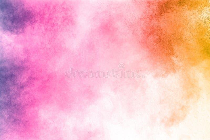 Explosión abstracta del polvo del multicolor en el fondo blanco fotos de archivo