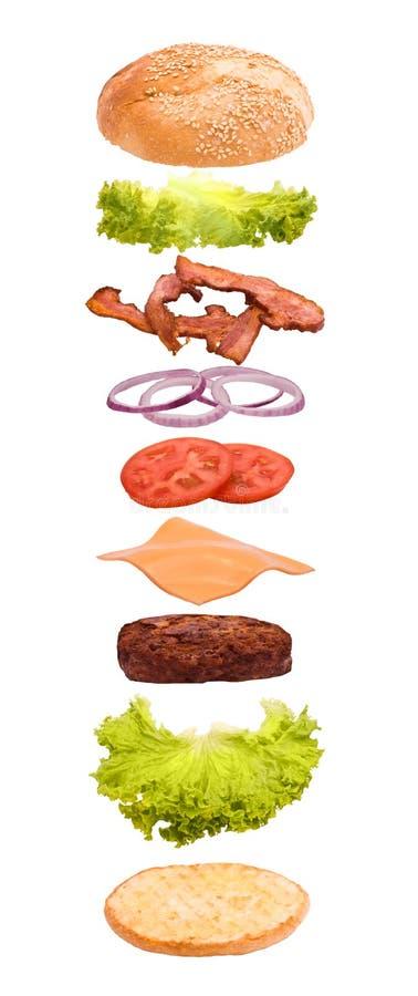 Explosión de la hamburguesa fotos de archivo