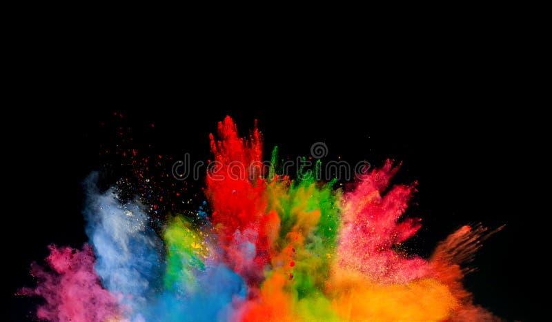 Explosión de polvo coloreada en fondo negro fotos de archivo
