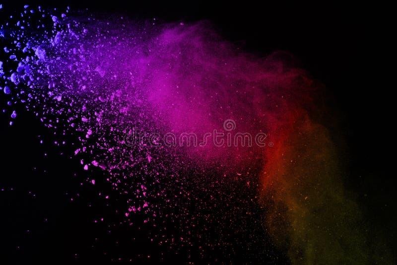 Explosión del polvo coloreado en fondo negro Colorido de dus fotos de archivo libres de regalías