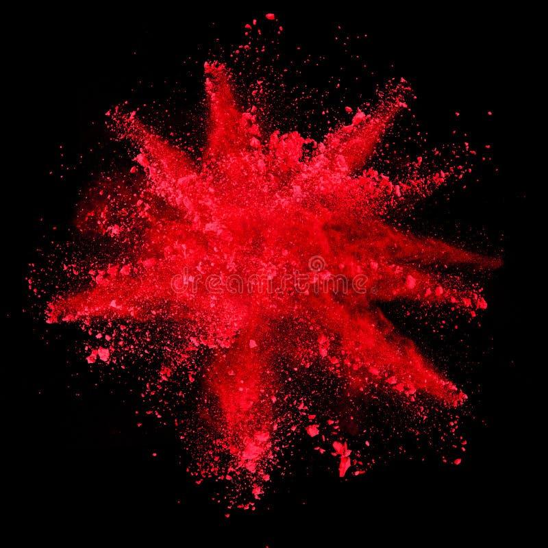 Explosión del polvo rojo en fondo negro ilustración del vector
