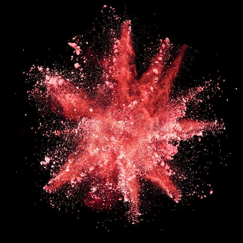Explosión del polvo rojo en fondo negro stock de ilustración