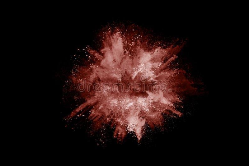 Explosi?n del polvo de Brown en fondo negro Movimiento del helada imágenes de archivo libres de regalías