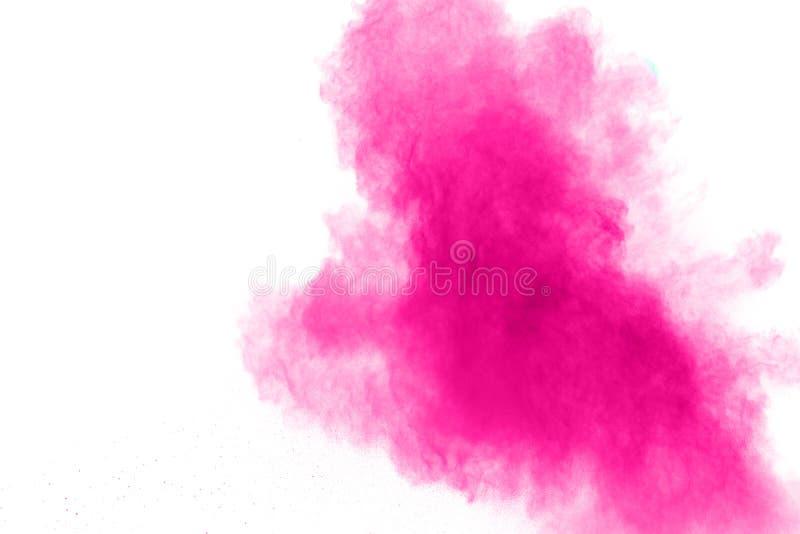Explosi?n rosada abstracta del polvo en el fondo blanco Movimiento del helada del polvo rosado salpicado foto de archivo