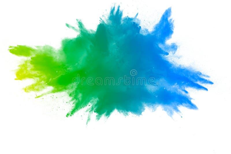 Explosie van groenachtig blauw kleurenpoeder op witte achtergrond stock afbeelding