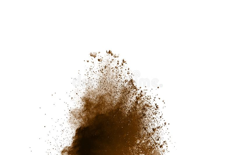 Distributed powder. Explosion of brown dust on white background royalty free stock photos
