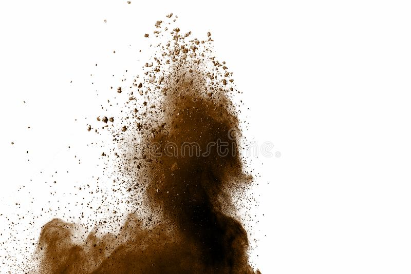 Distributed powder. Explosion of brown dust on white background royalty free stock image