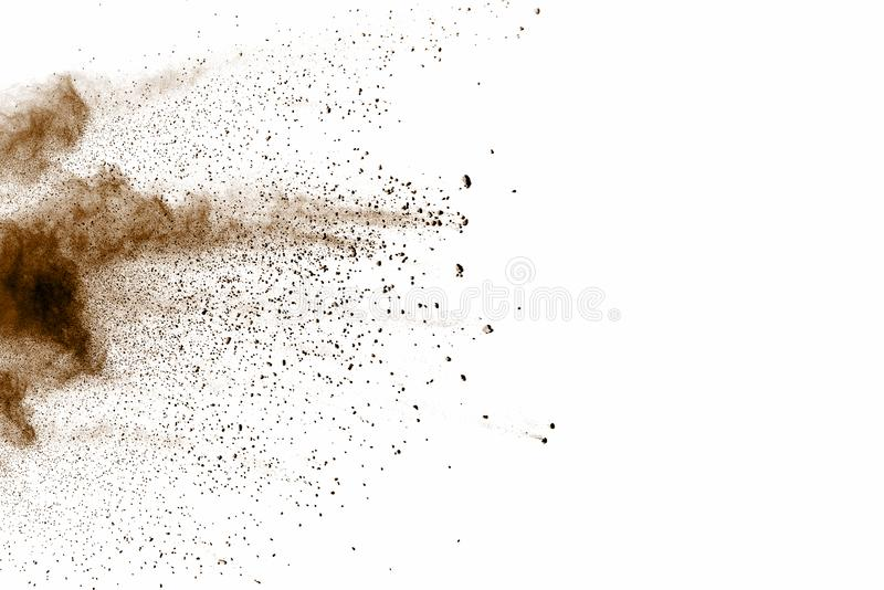Distributed powder. Explosion of brown dust on white background stock images