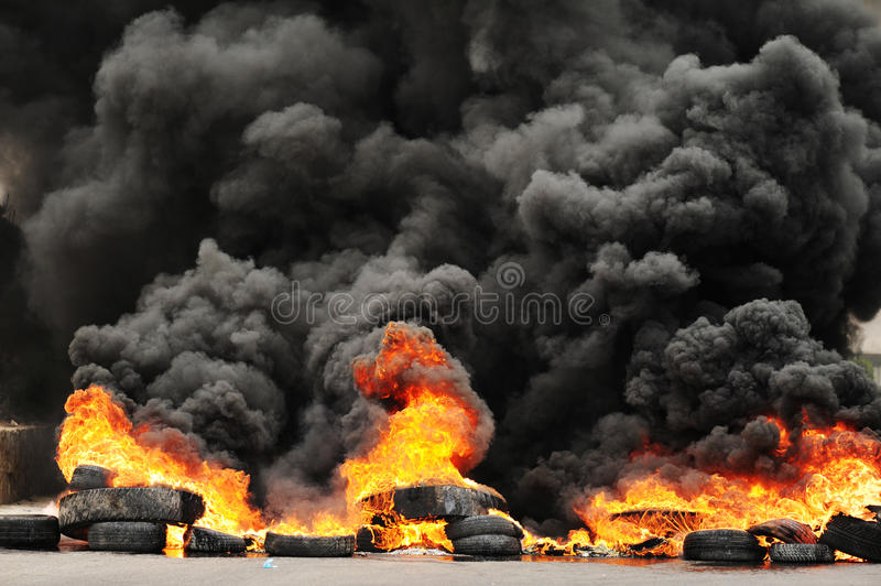 Explosion and burning wheels causing huge dark smo stock photos