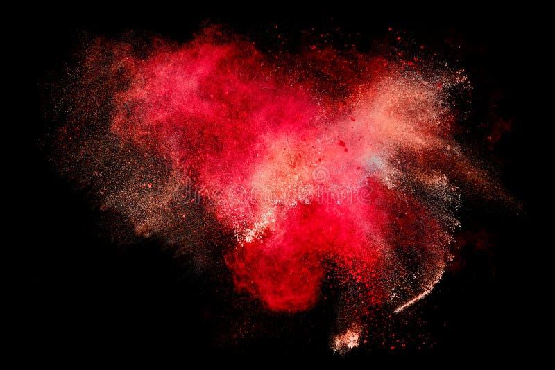 Explosion colorée de particules de poussière d'isolement sur le fond noir images stock