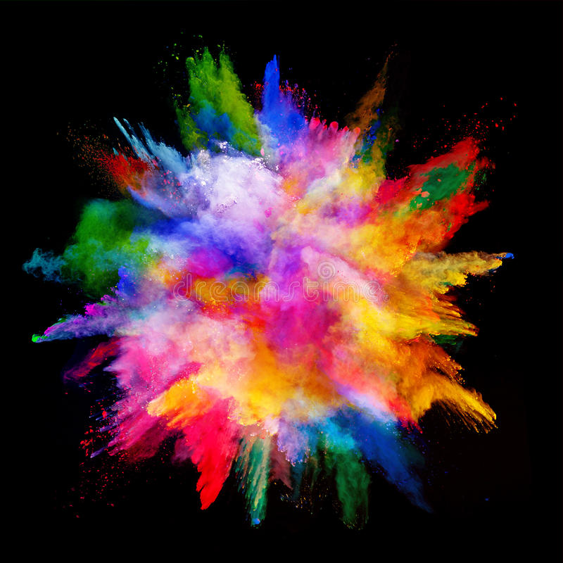 Explosion of colored powder on black background stock image