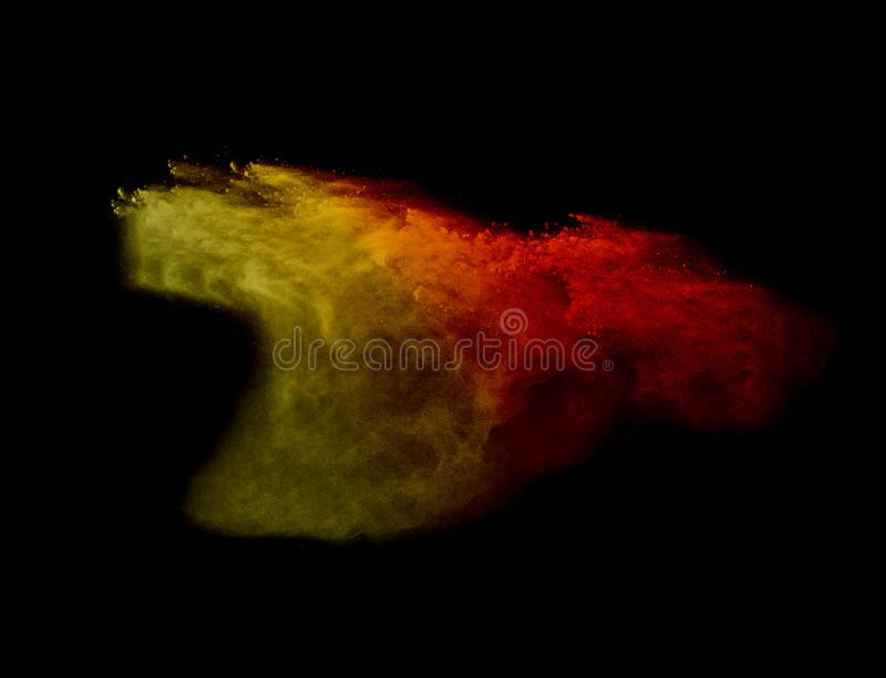 Explosion of colored powder explosion on black background stock images