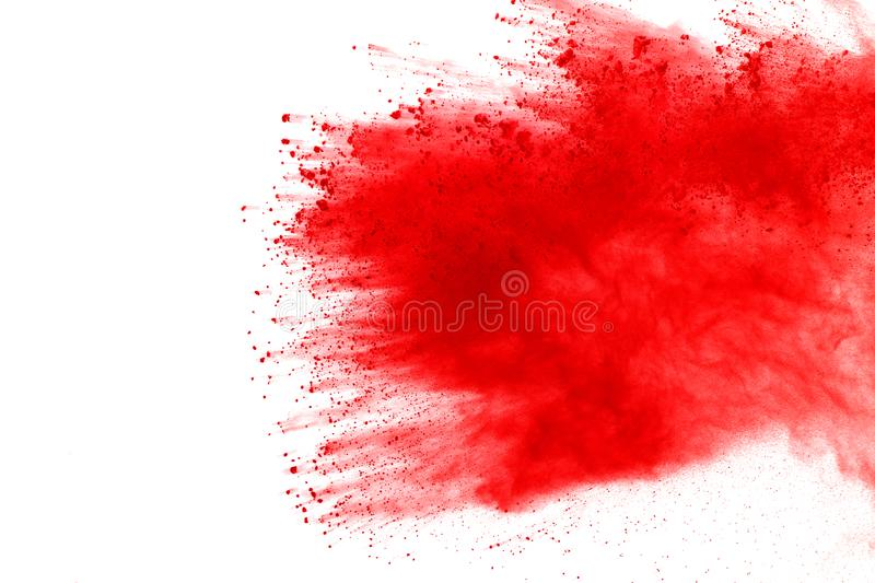 Explosion of colored powder, isolated on white background. Abstract of colored dust splatted. Color cloud. Abstract of red powder explosion on white background royalty free stock photos
