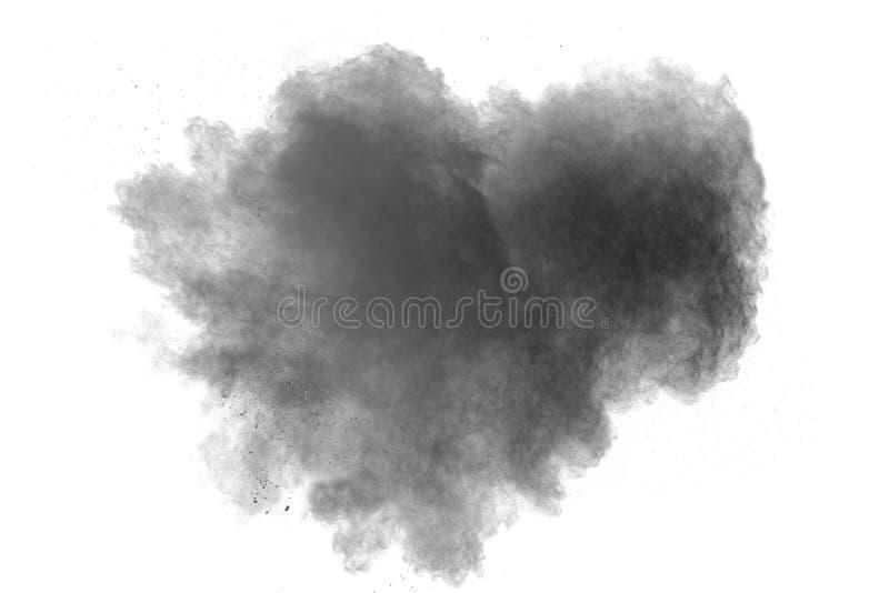 Explosion de poudre noire sur le fond blanc Forme de coeur images libres de droits