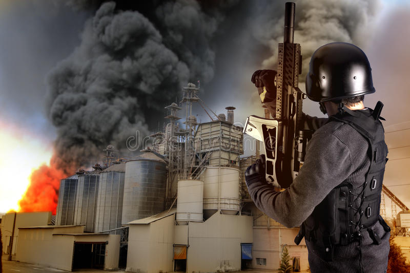 Explosion in an industry, armed police stock images