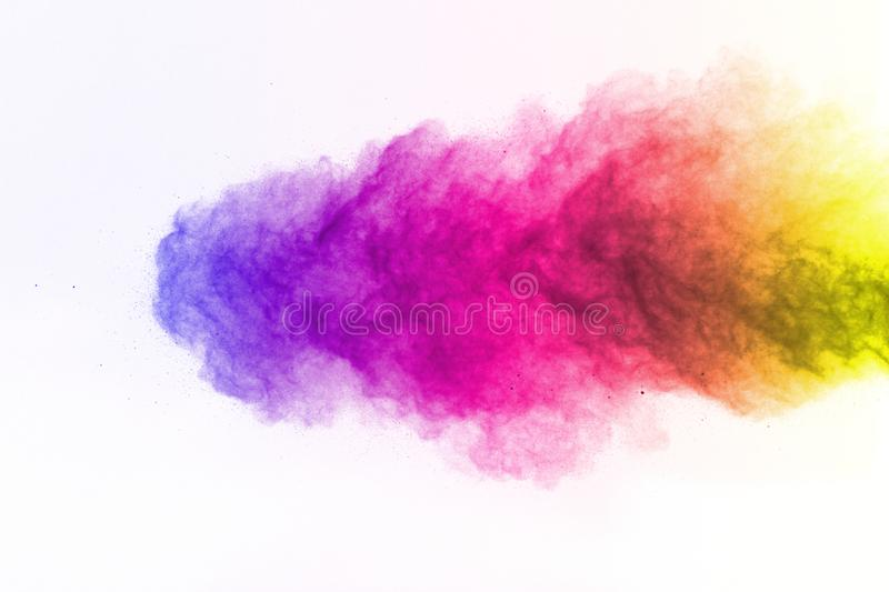 The explosion of multi colored powder. Freeze motion of color po stock image