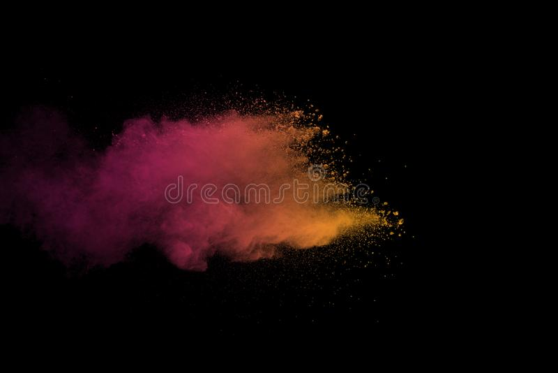 Explosion of multicolored dust on black background. Stopping the movement of multicolored dust on black background royalty free stock image