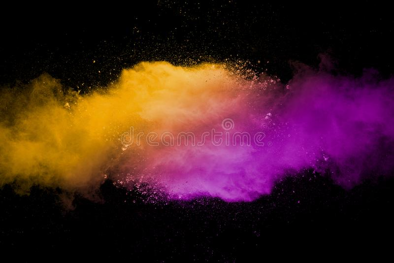 Explosion of multicolored dust on black background. Stopping the movement of multicolored dust on black background royalty free stock images