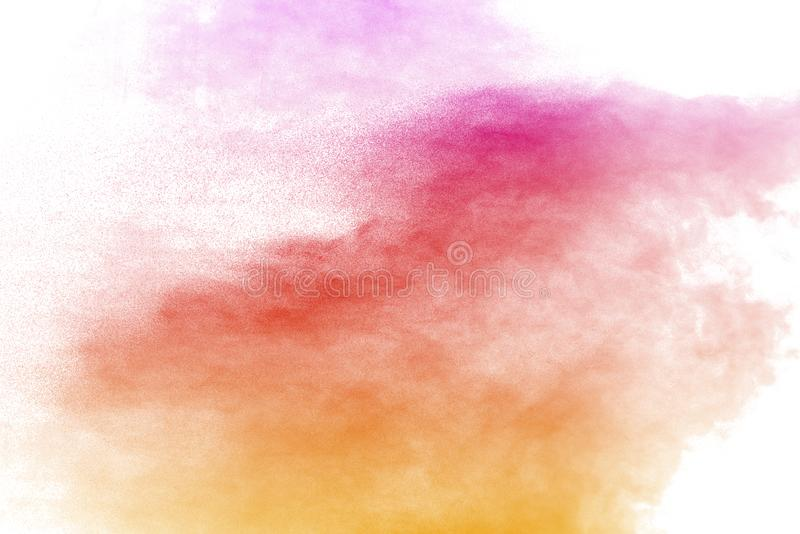 Explosion of multicolored dust on white background. Stopping the movement of multicolored dust on white background royalty free stock image