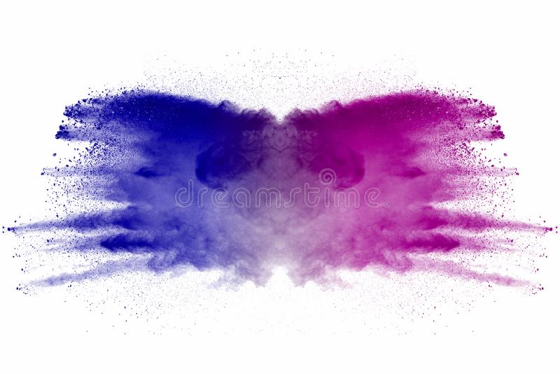 Explosion of multicolored dust on white background. Stopping the movement of multicolored dust on white background stock photo