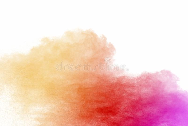 Explosion of multicolored dust on white background. Stopping the movement of multicolored dust on white background stock images