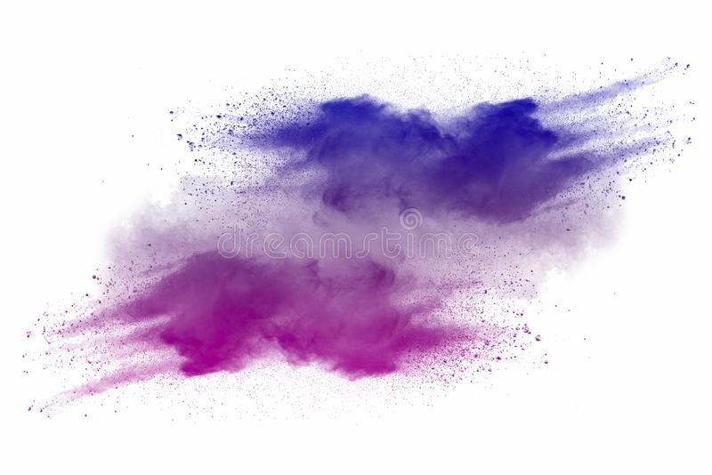 Explosion of multicolored dust on white background. Stopping the movement of multicolored dust on white background royalty free stock photo