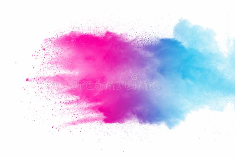 Explosion of multicolored dust on white background. Stopping the movement of multicolored dust on white background royalty free stock images
