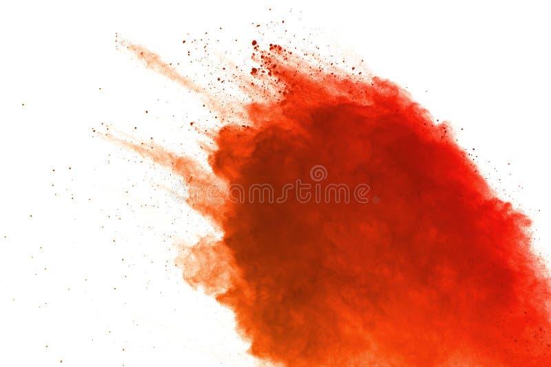 Explosion orange de poudre sur le fond blanc Nuage coloré La poussière colorée éclatent Peignez Holi photos stock