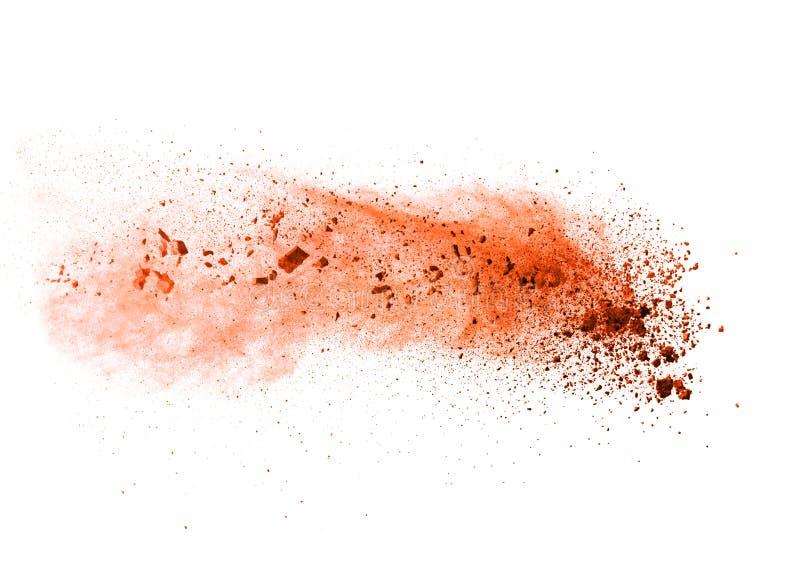 Explosion of orange powder on white background stock images