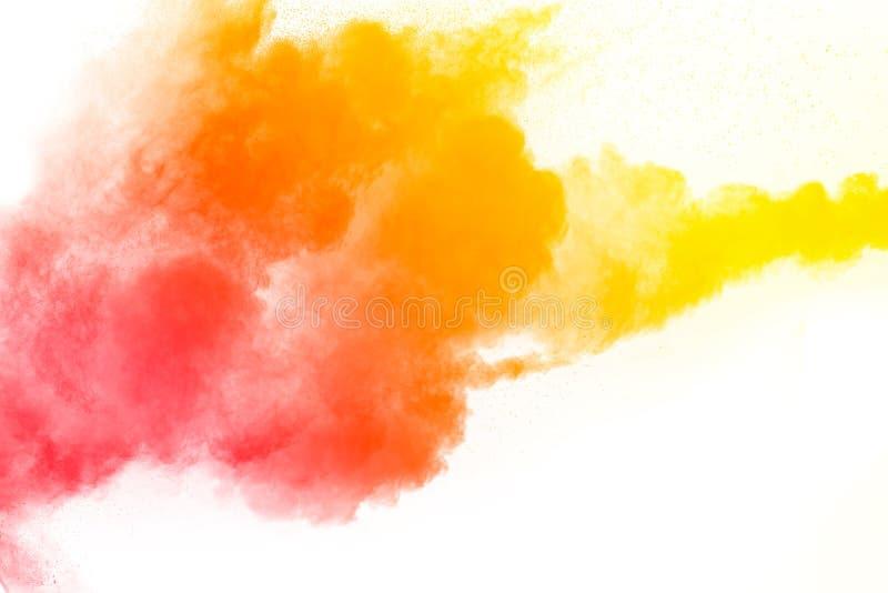 Explosion orange rouge de poudre de couleur photo stock
