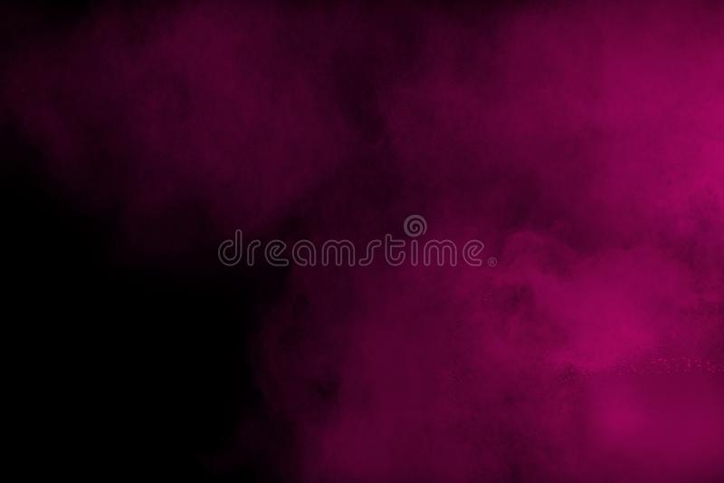 Explosion of pink colored powder  isolated on black background royalty free stock images