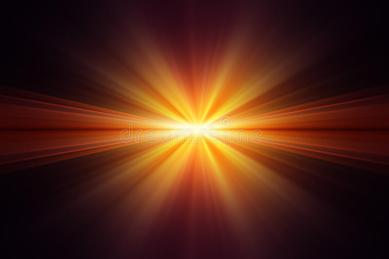 Explosion of yellow light on black background. Rays of light yellow and orange stock photos