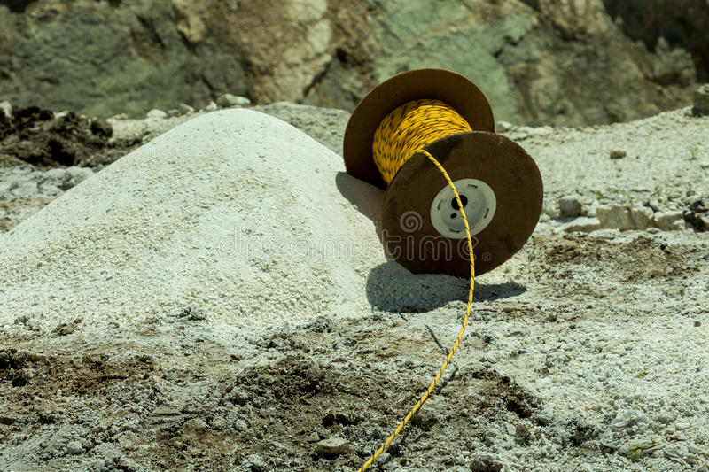 Explosive cord. Yellow explosive cord on a mining blastin stock photography