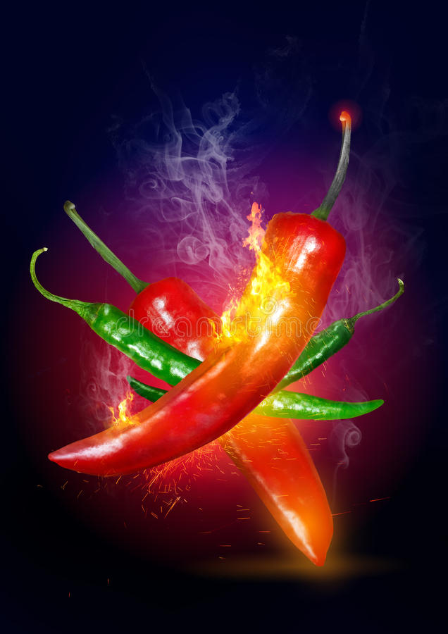 Explosive Hot Chili. Red and green hot and on fire red Chili pepper royalty free stock photo