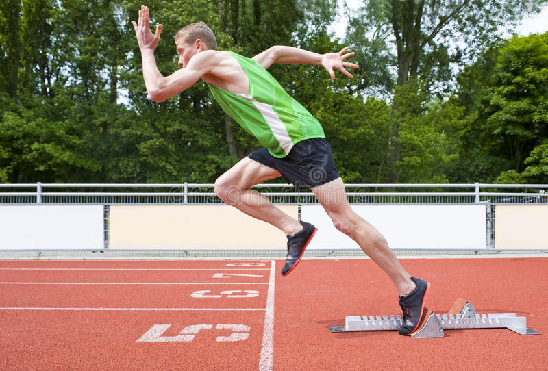 Explosive start. Of an Athlete leaving the starting blocks on a sprint run stock photos