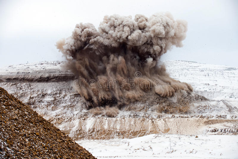 Explosive works on open pit. Gold mining stock photo