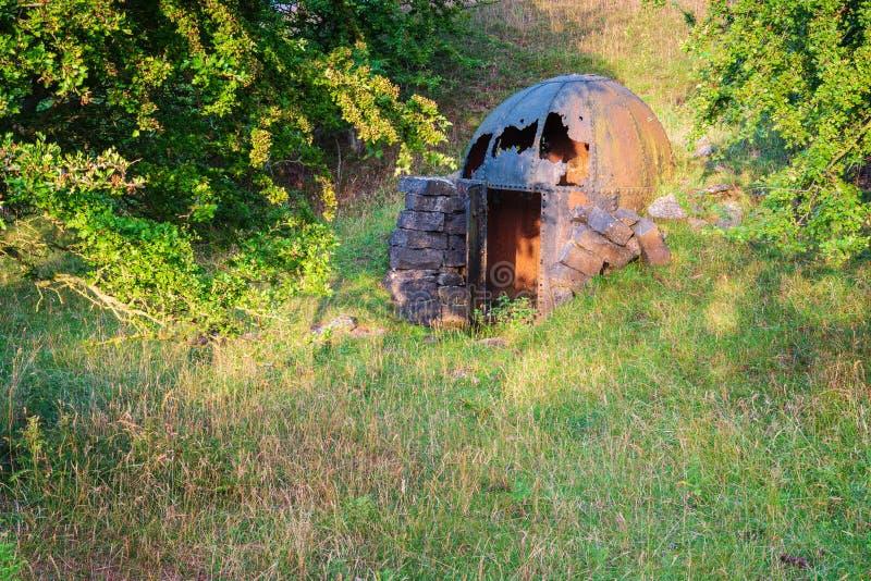Explosivos de acero viejos vertidos en la mina de Littlemill imagenes de archivo