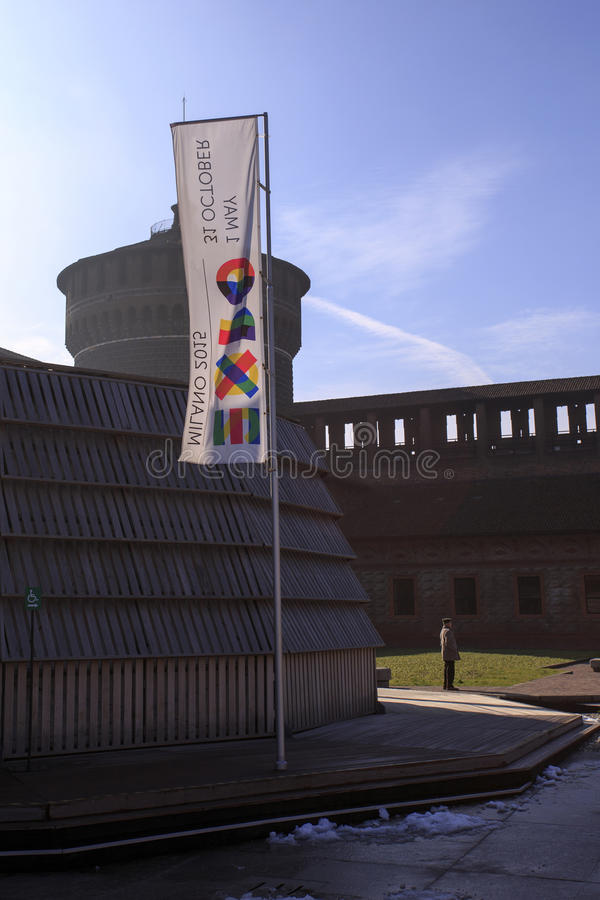 The 2015 expo flags in front of the castle of Milan stock photo