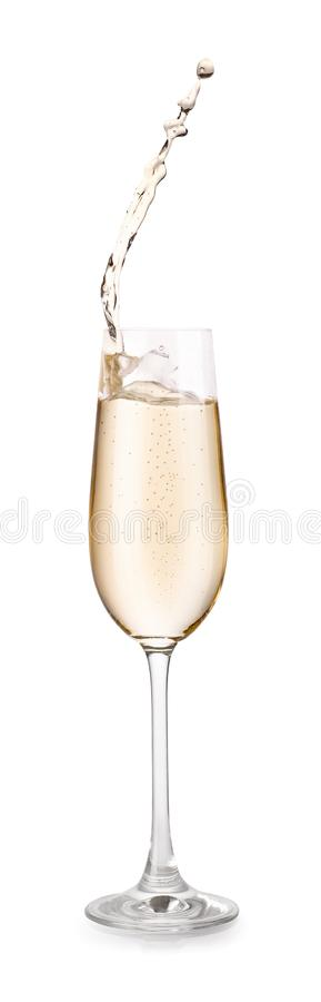 Exponeringsglas av champagne med färgstänk royaltyfri bild