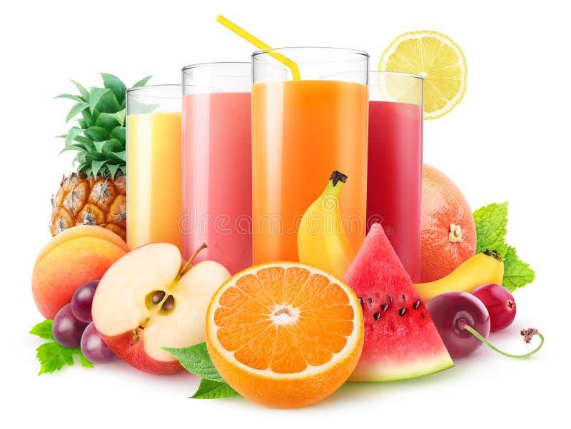 Exponeringsglas av den nya fruktsaft och högen av frukter arkivfoto