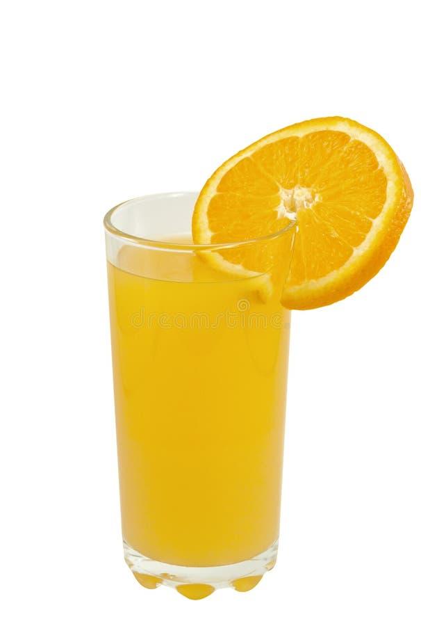Exponeringsglas av orange fruktsaft och den orange skivan royaltyfri fotografi