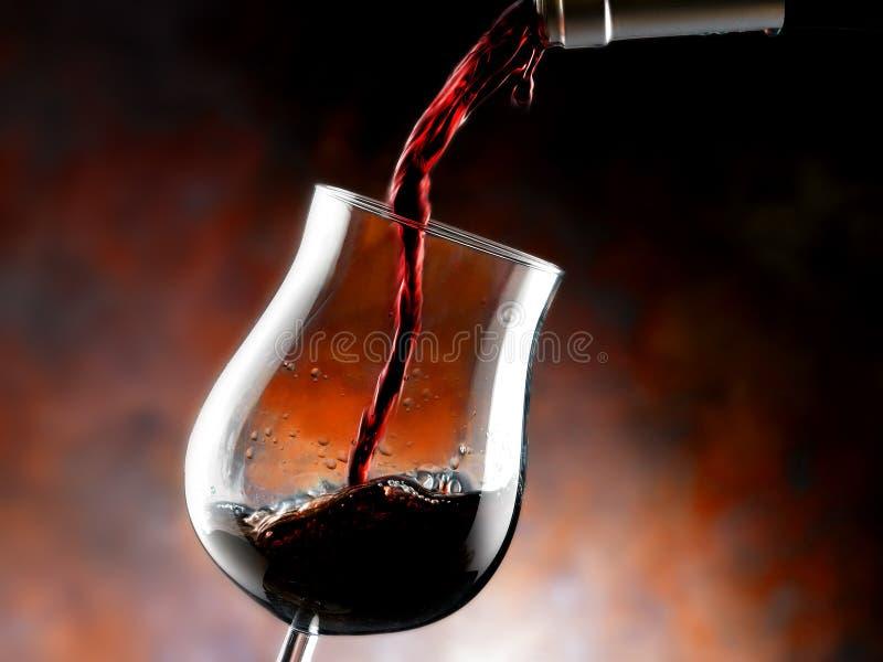 Exponeringsglas av rött vin arkivfoton