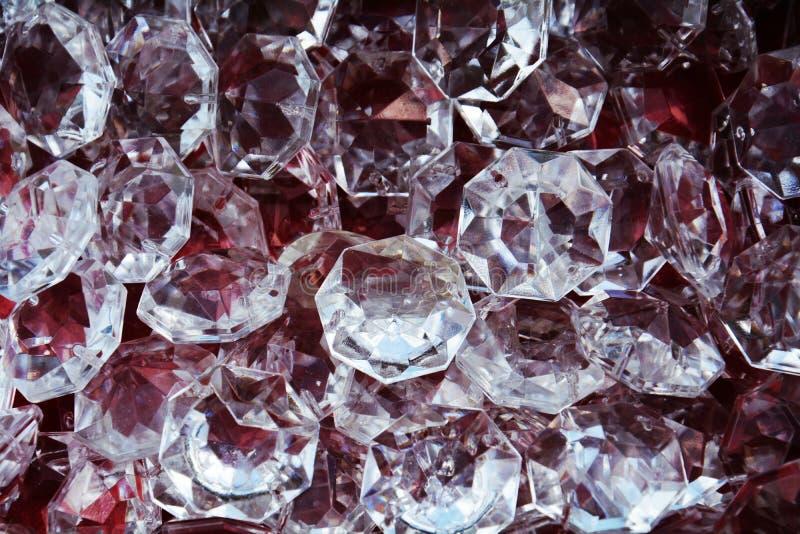 Exponeringsglas gillar diamanter smycken, bakgrund arkivbild