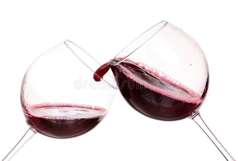 Exponeringsglas med rött vin royaltyfria foton