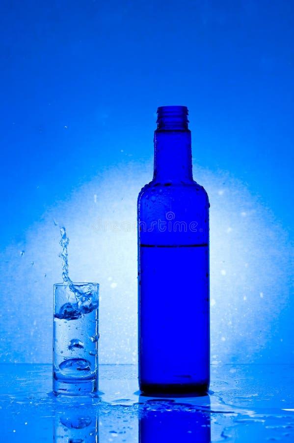 Exponeringsglas med vatten arkivbilder