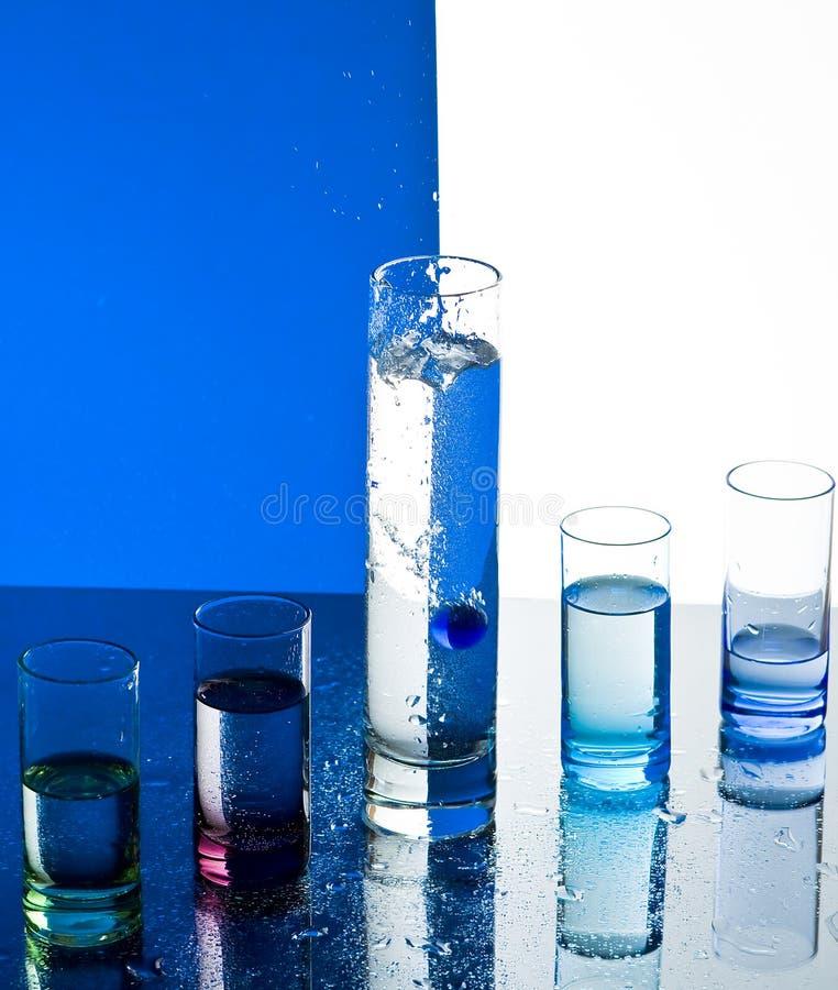 Exponeringsglas med vatten arkivbild