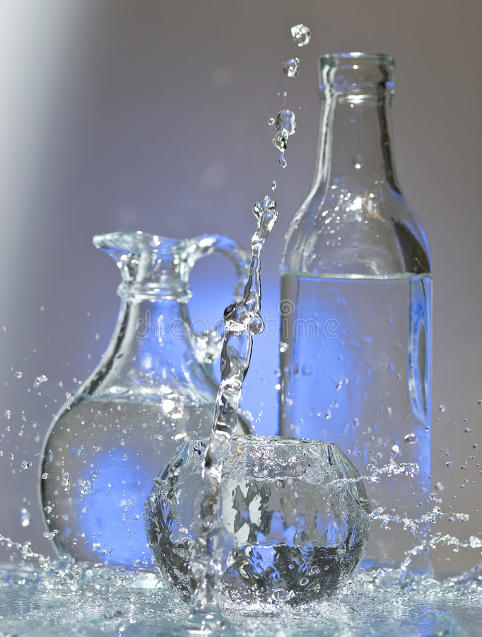Exponeringsglas med vatten royaltyfri fotografi