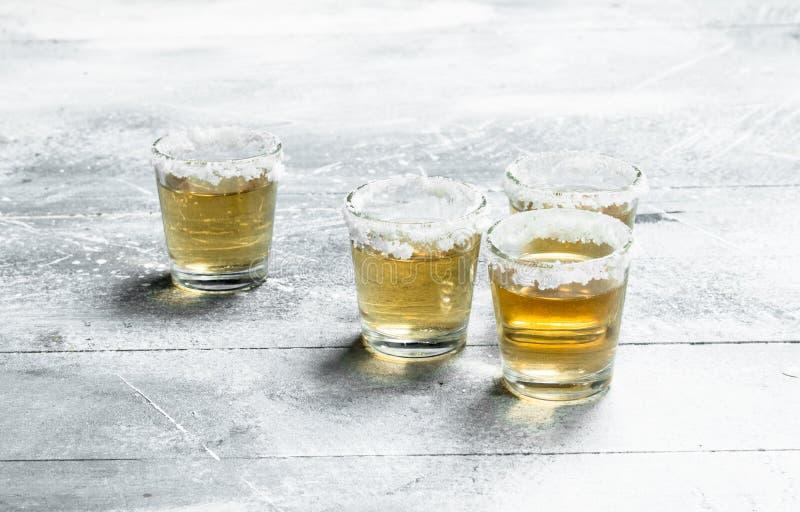 exponeringsglas skjuten tequila fotografering för bildbyråer