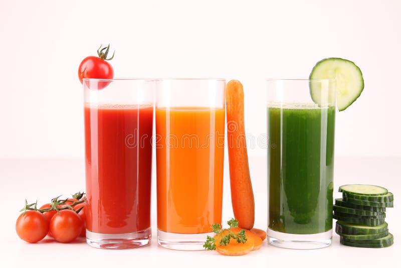 exponeringsglasfruktsaftgrönsaker arkivfoto