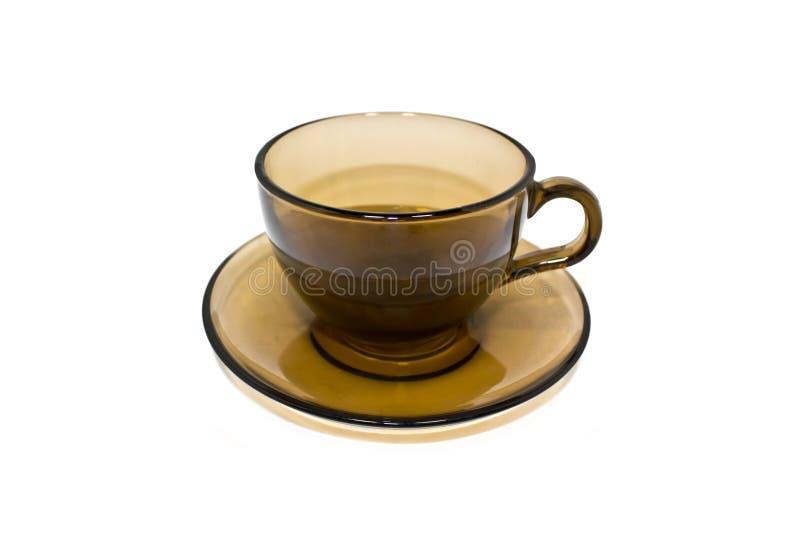 Exponeringsglaskopp och tefat, tepar, brunt exponeringsglas arkivfoto